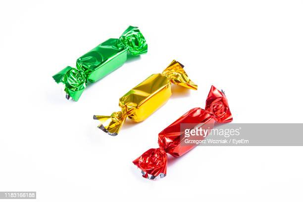 high angle view of multi colored candies against white background - sweet food stock pictures, royalty-free photos & images