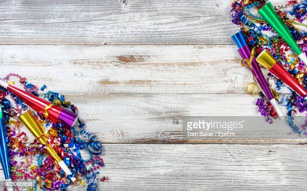 High Angle View Of Multi Colored Confetti On Table