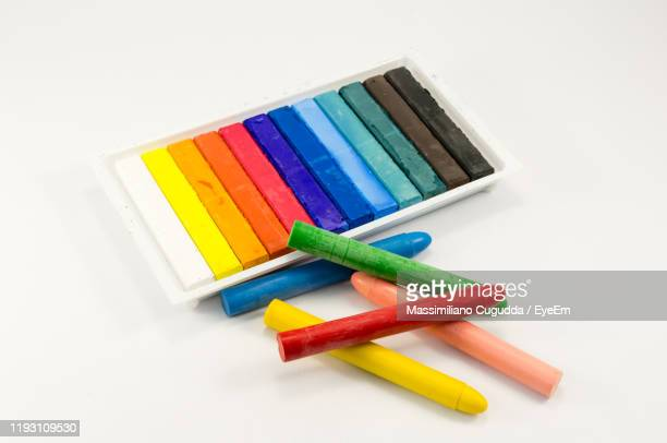 high angle view of multi colored crayons on white background - クレヨン ストックフォトと画像