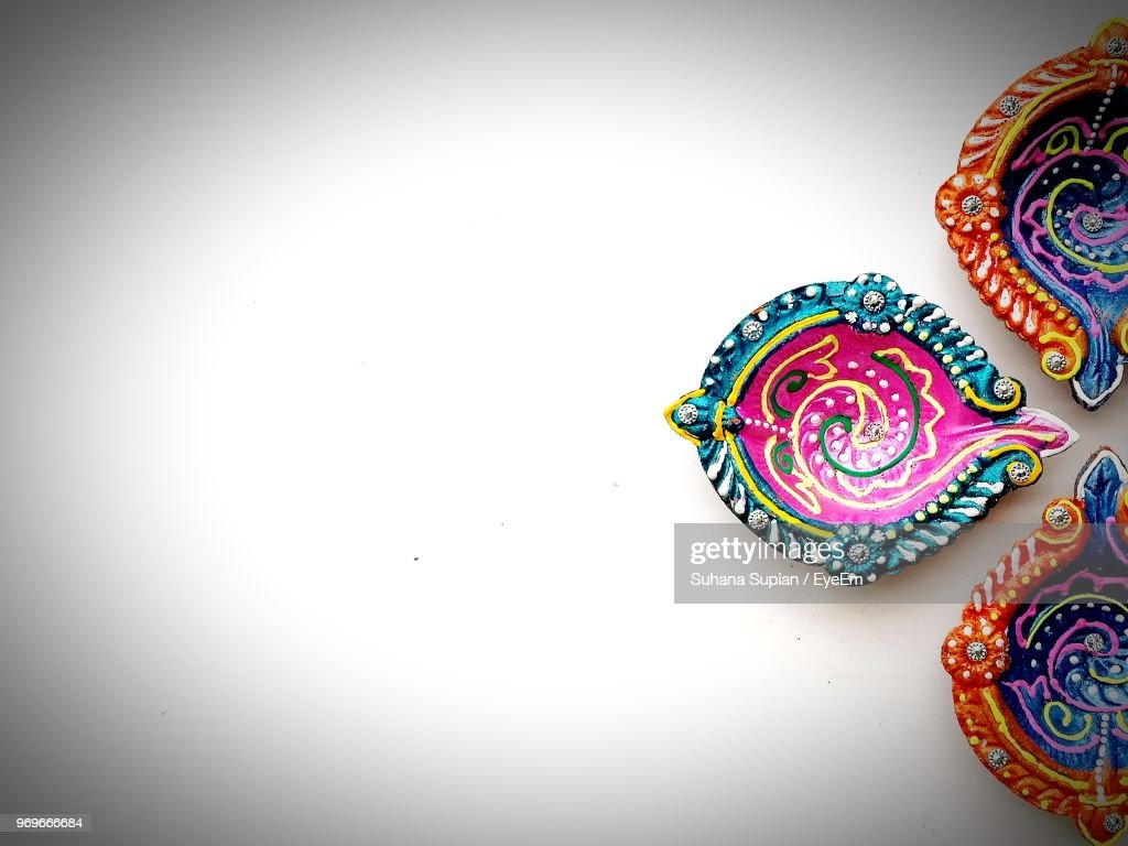 High Angle View Of Multi Colored Diya On White Background : Stock Photo