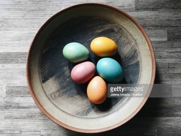 high angle view of multi colored eggs on table - jelena ivkovic stock pictures, royalty-free photos & images
