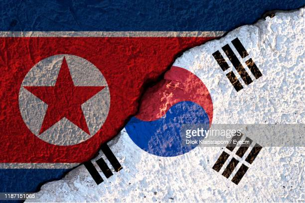 high angle view of multi colored flag against blue background - korea stock pictures, royalty-free photos & images