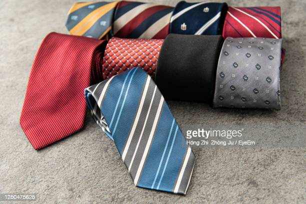 high angle view of multi colored neckties on floor - menswear stock pictures, royalty-free photos & images