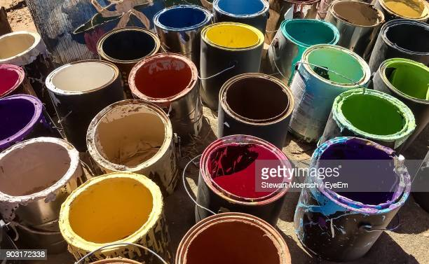 High Angle View Of Multi Colored Paint Cans