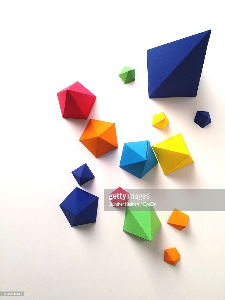 High Angle View Of Multi Colored Paper Pyramids : Stock Photo