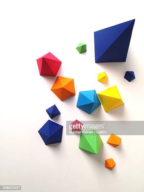 high angle view of multi colored paper pyramids - group of objects stock photos and pictures
