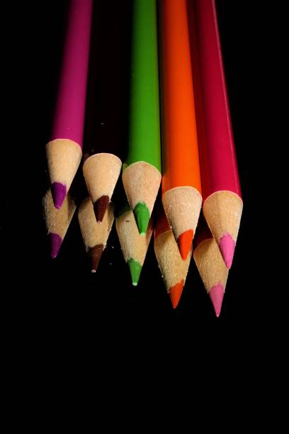 High Angle View Of Multi Colored Pencils On Black Background