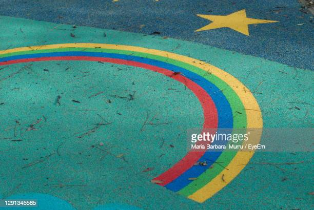 high angle view of multi colored rainbow a on street - treviso italy stock pictures, royalty-free photos & images