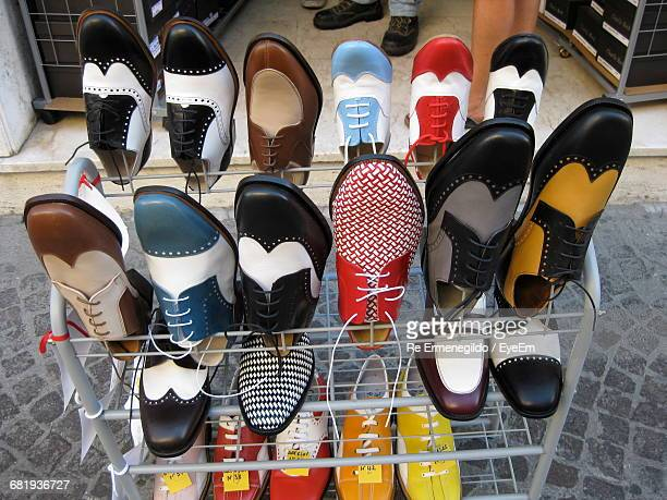High Angle View Of Multi Colored Shoes In Rack On Sidewalk