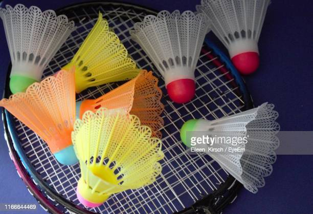 high angle view of multi colored shuttlecocks and rackets on table - eileen kirsch stock pictures, royalty-free photos & images