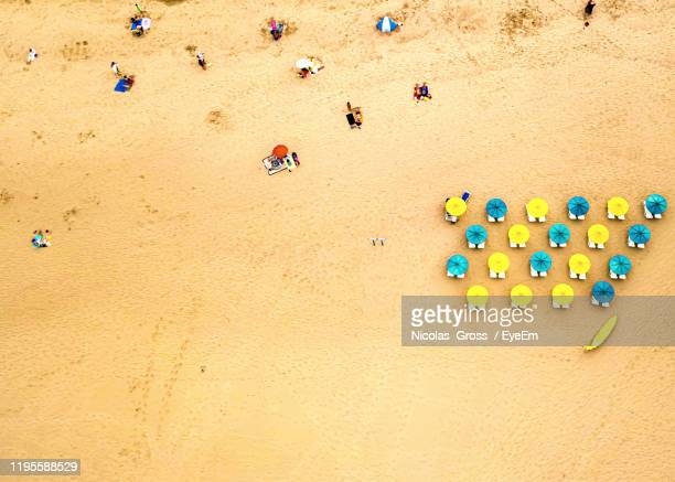 high angle view of multi colored umbrellas on sand at beach - ザグレス ストックフォトと画像