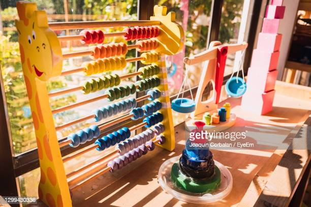 high angle view of multi colored umbrellas on table - montessori education stock pictures, royalty-free photos & images