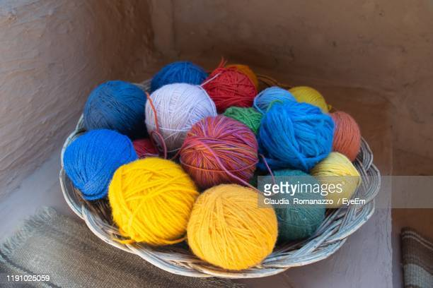 high angle view of multi colored wool on table - claudia romanazzo foto e immagini stock