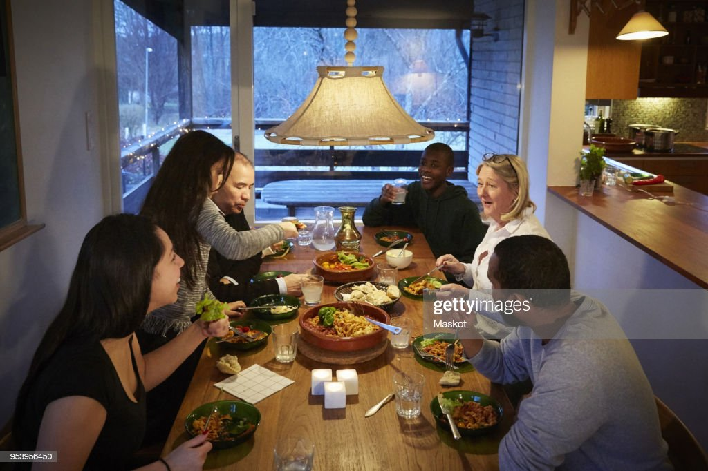 High angle view of multi-generation family enjoying meal at table : Stock Photo
