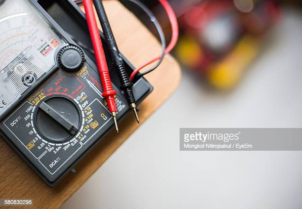 High Angle View Of Multimeter On Table