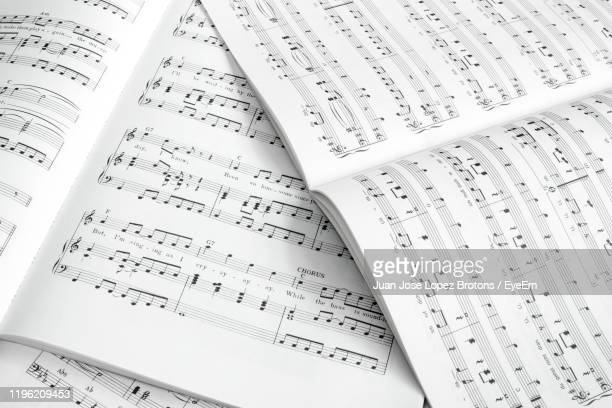 high angle view of musical notes - sheet music stock pictures, royalty-free photos & images