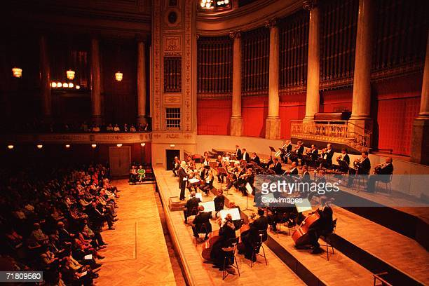 high angle view of musicians playing at a concert, hofburg concert orchestra, hofburg palace, vienna, austria - concert hall stock pictures, royalty-free photos & images
