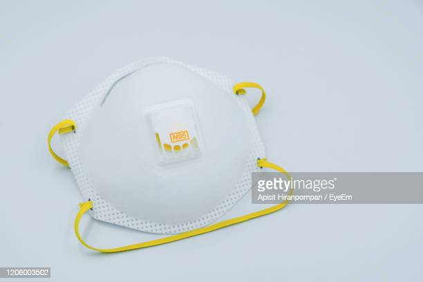 high angle view of n95 mask against white background - mask stock pictures, royalty-free photos & images