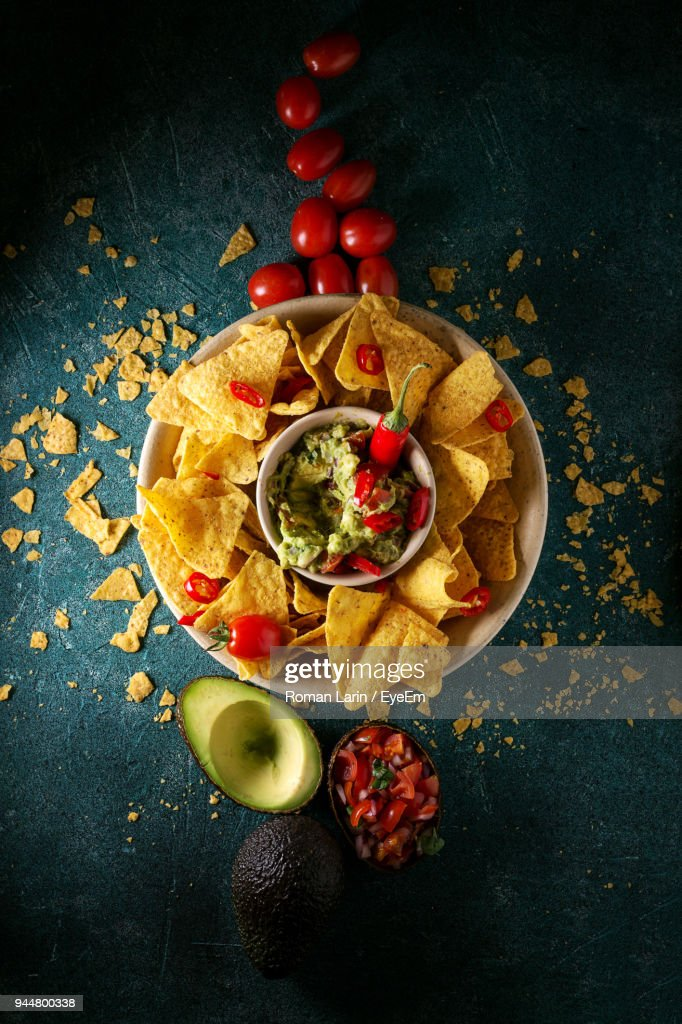 High Angle View Of Nacho Chips With Dip On Table : Stock Photo