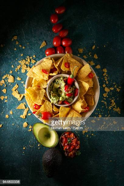 high angle view of nacho chips with dip on table - nachos stock photos and pictures