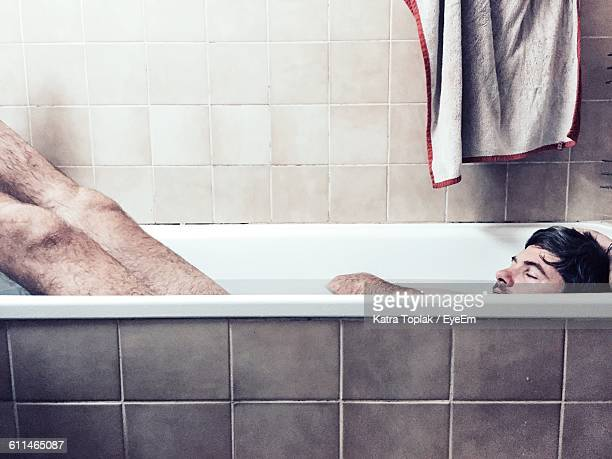 High Angle View Of Naked Man In Bathtub At Home
