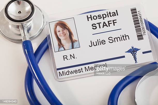 High angle view of name badge and stethoscope, studio shot