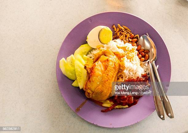 High Angle View Of Nasi Lemak Served In Plate On Table