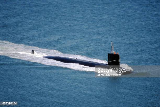 High Angle View Of Navy Submarine In Sea Against Sky