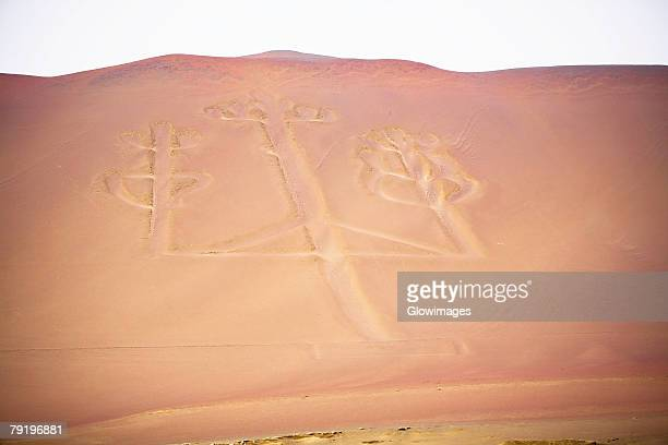 high angle view of nazca lines making a shape of candlestick holder, paracas peninsula, paracas national reserve, paracas, ica region, peru - nazca lines stock pictures, royalty-free photos & images