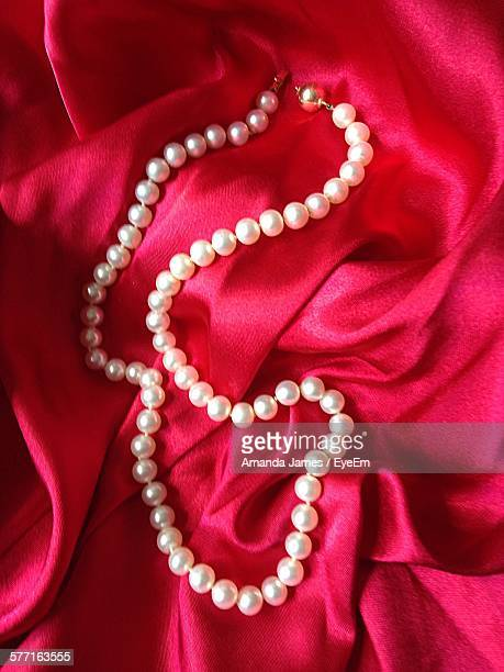 High Angle View Of Necklace On Textile