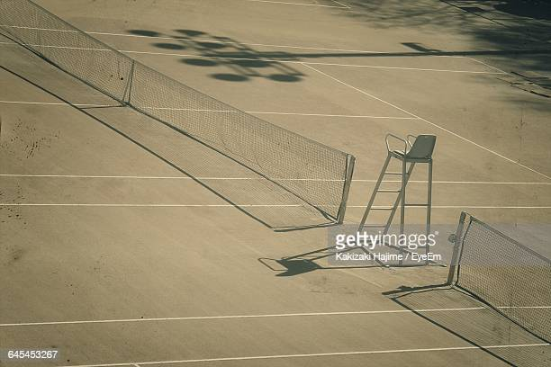High Angle View Of Net At Empty Tennis Court