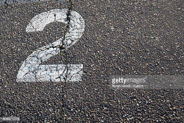 high angle view of number 2 on road - number 2 stock pictures, royalty-free photos & images