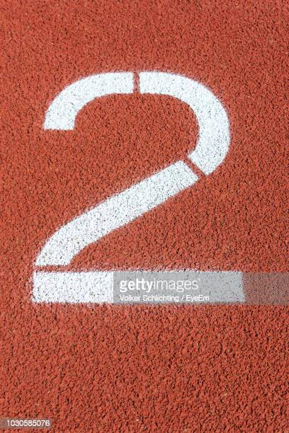 high angle view of number 2 on running track - number 2 stock pictures, royalty-free photos & images