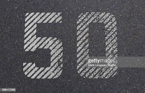 high angle view of number 50 on road - number 50 stock photos and pictures