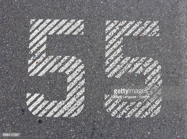 high angle view of number 55 on road - speed limit sign stock photos and pictures
