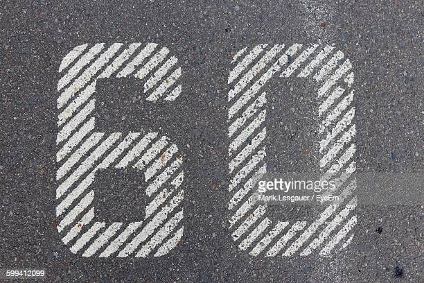 high angle view of number 60 on road - number 60 stock photos and pictures