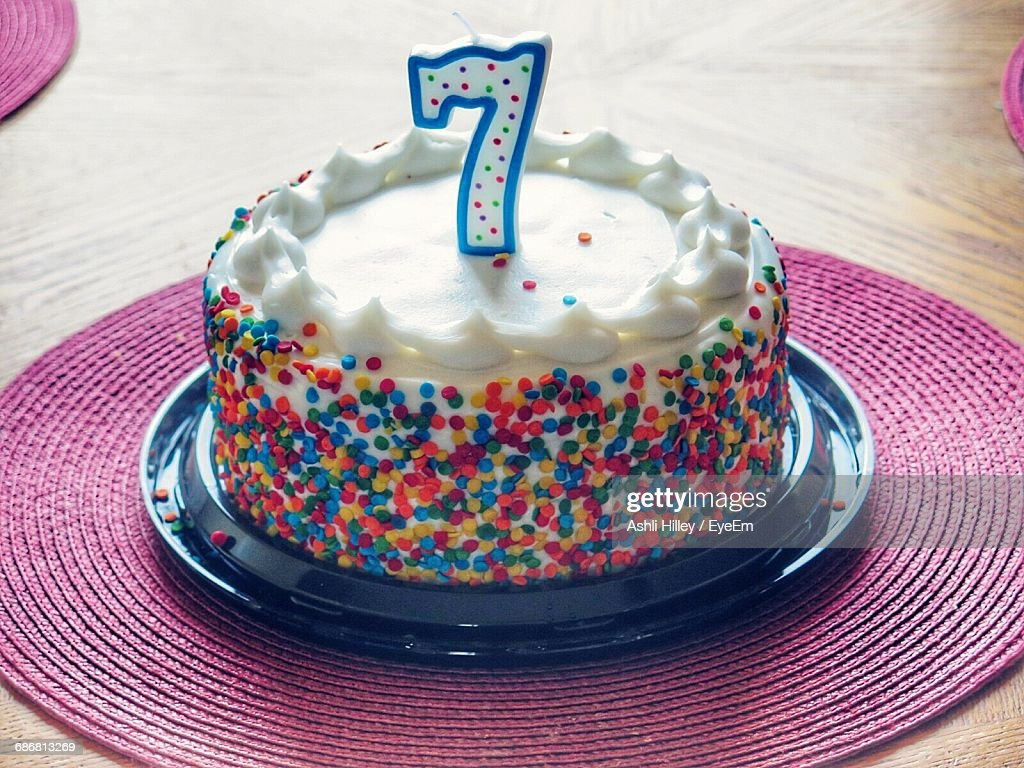 High Angle View Of Number 7 Candle On Birthday Cake Stock Photo