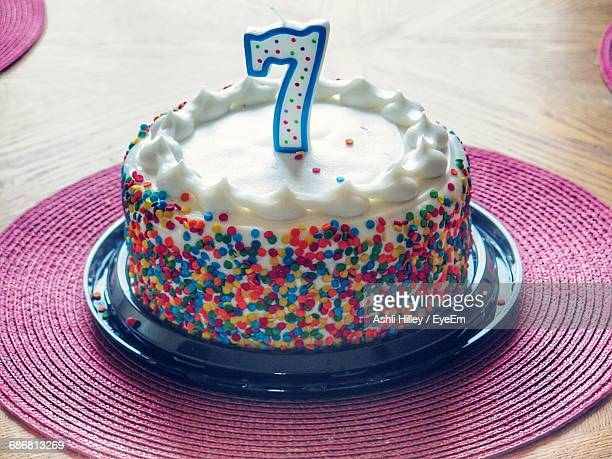High Angle View Of Number 7 Candle On Birthday Cake