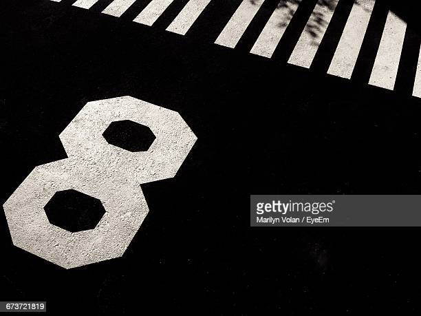 high angle view of number 8 on street - number 8 stock pictures, royalty-free photos & images