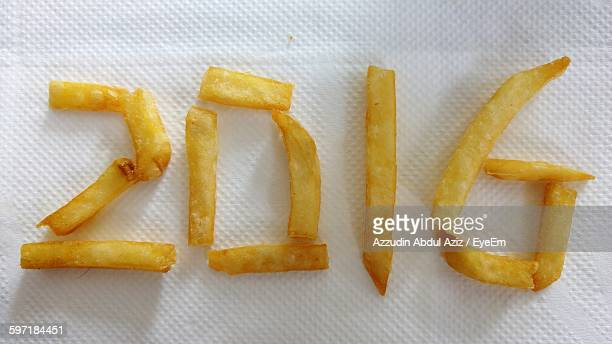 High Angle View Of Number Made From French Fries
