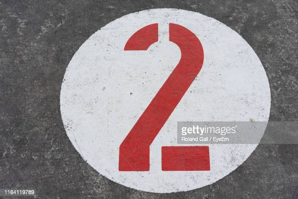 high angle view of number on road - number 2 stock pictures, royalty-free photos & images