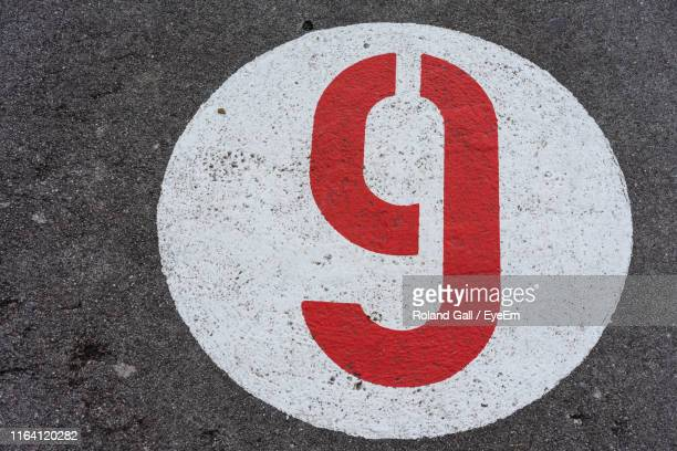 high angle view of number on road - number 9 stock pictures, royalty-free photos & images