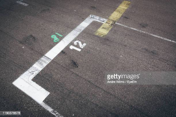 high angle view of number on road - andre wilms eyeem stock-fotos und bilder