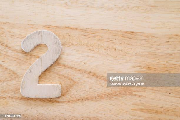 high angle view of number on wooden table - number 2 stock pictures, royalty-free photos & images