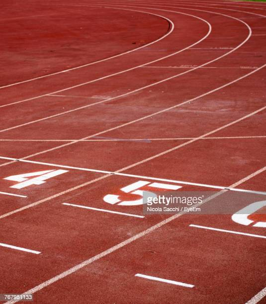 high angle view of numbers on running track - track and field stadium stock pictures, royalty-free photos & images