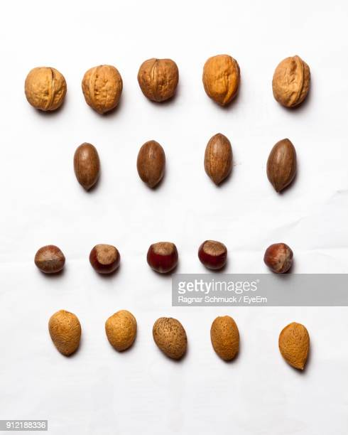 High Angle View Of Nuts Against White Background