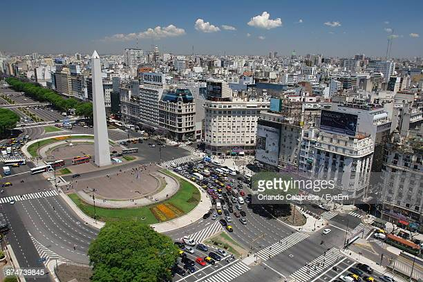 high angle view of obelisco de buenos aires by buildings in city - obelisco de buenos aires fotografías e imágenes de stock