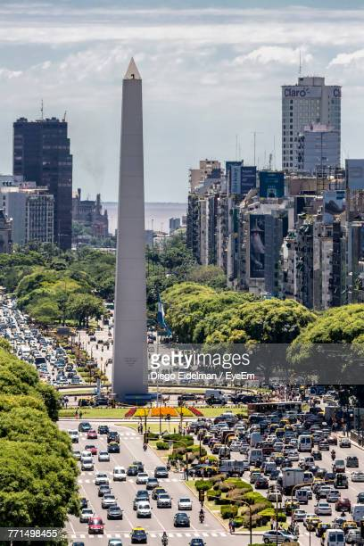 High Angle View Of Obelisk Amidst Cars On Road In City
