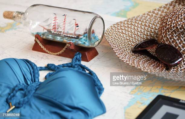 high angle view of object on map - ship in a bottle stock pictures, royalty-free photos & images