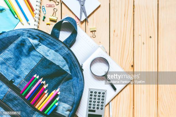 high angle view of objects on table - rucksack stock pictures, royalty-free photos & images